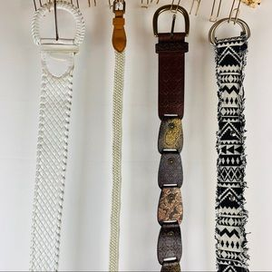 4 women's belts including one Fossil